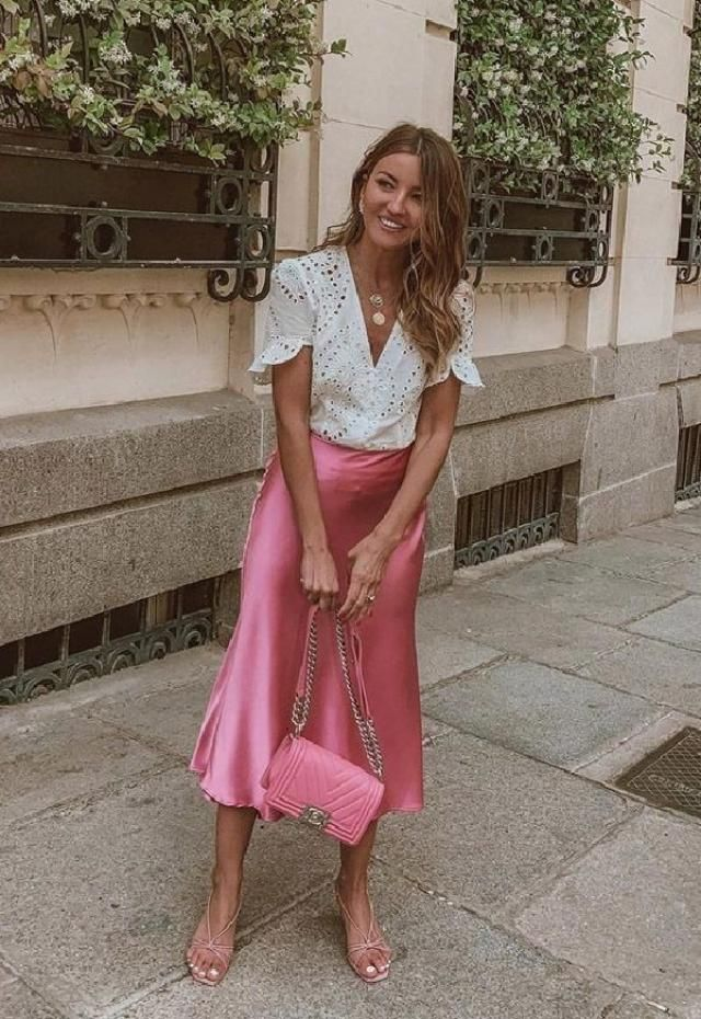 Hotpink skirtslook modish with blouses, shirts and high-neck tops. An off-shoulder off-white blouse would compleme…