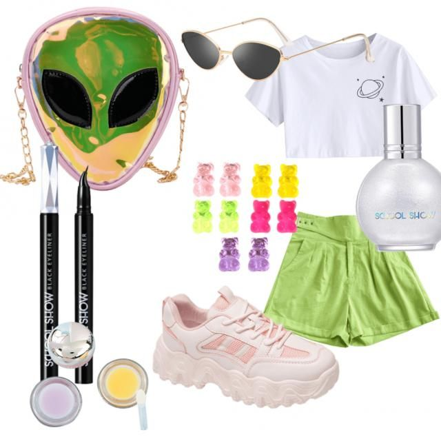 The main out fit is to represent the colours of the bag the sunglasses represent the alien eye look and the eye lin…