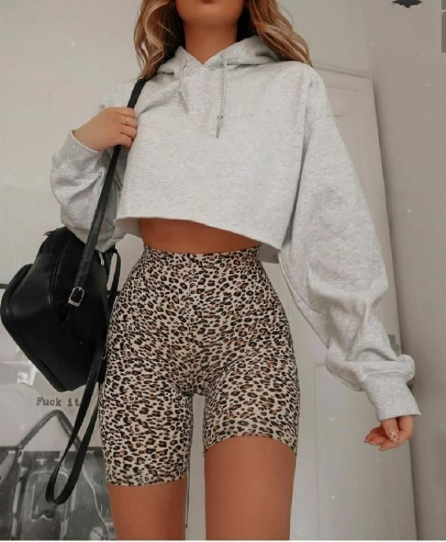 Leopard biker shorts can wear on cool outfit like this. Crop top sweatshirt in neutral color and black backpack is …