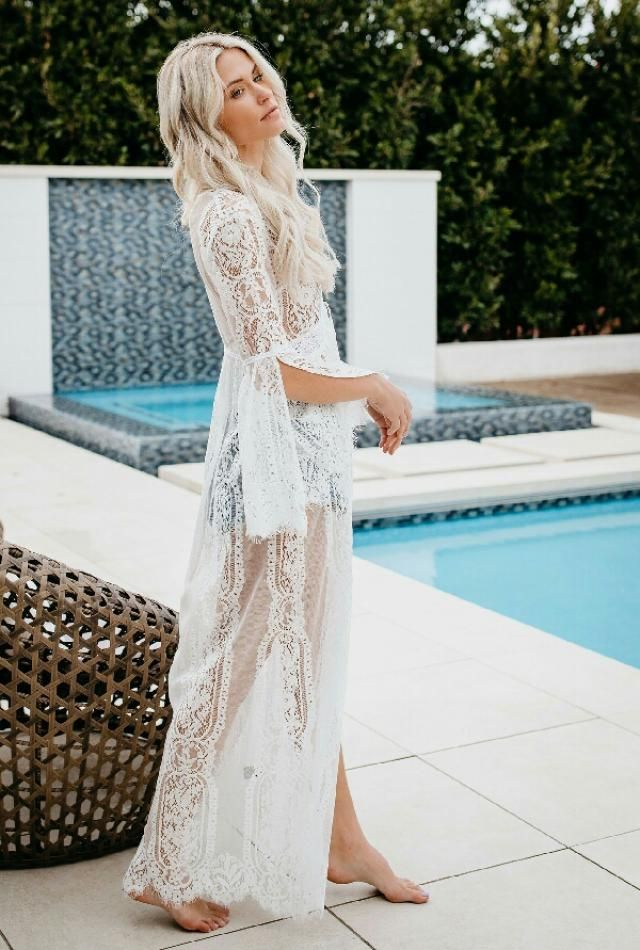 This summer stay elegant and sexy at the beach side by wearing this white see through cover up dress