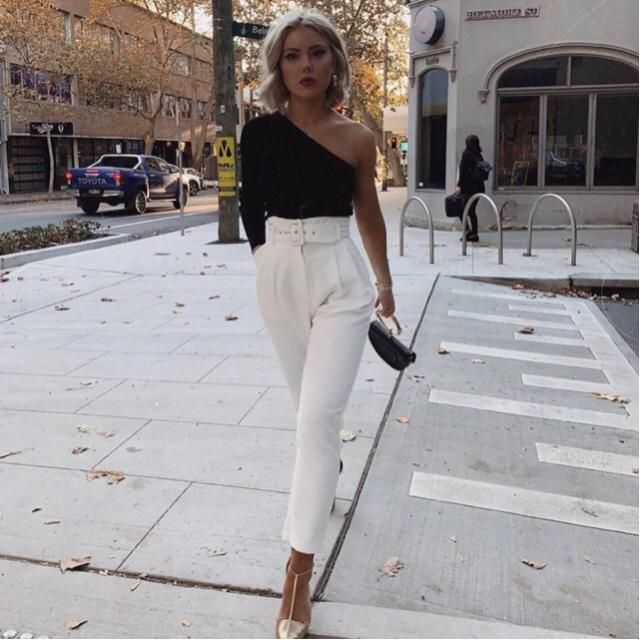 Classy elegant one shoulder black top with white classy pants