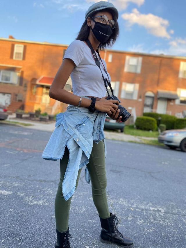 Simple white crop with high waisted green skinny jeans and to compliment a light blue button-up that matches a light bl…