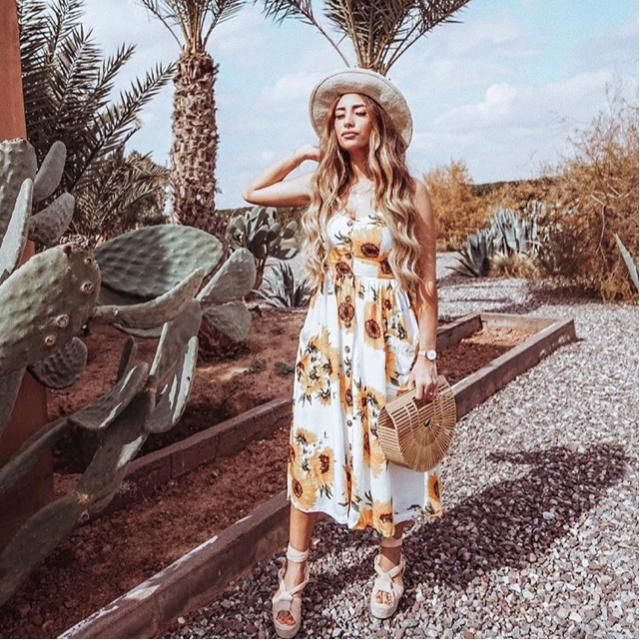Bright day under the sun with a sunflower dress
