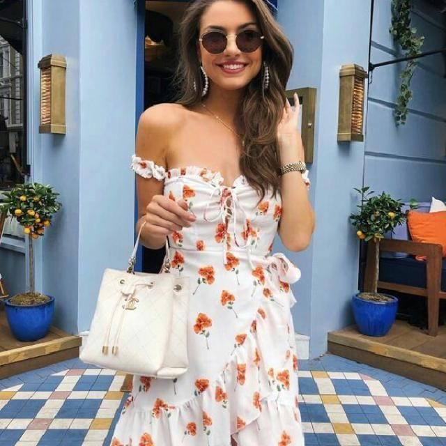 You can look stylish by wearing a little floral white dress