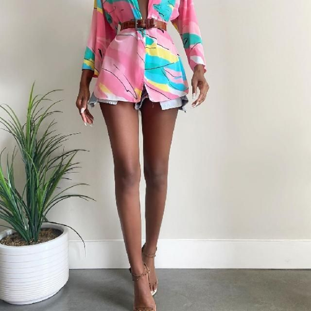 A belted colorful blazer with denim shorts for classy summer dates. Can also be alternated with colorful short slee…