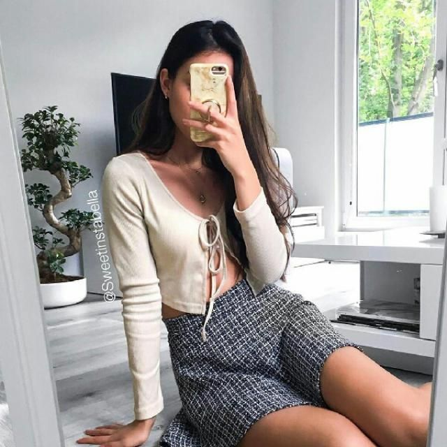 I love this ribbed tie front crop top with plaid skirts