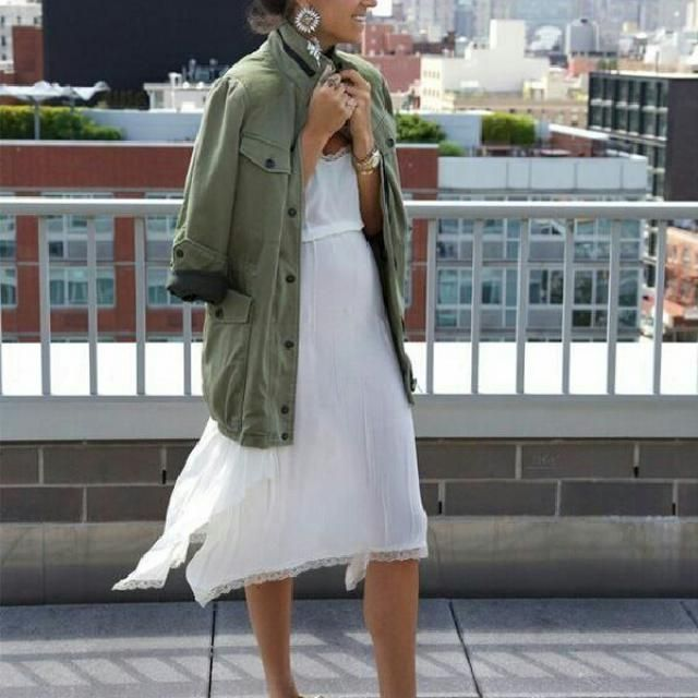 This is a chic way to wear a white dress with green jacket