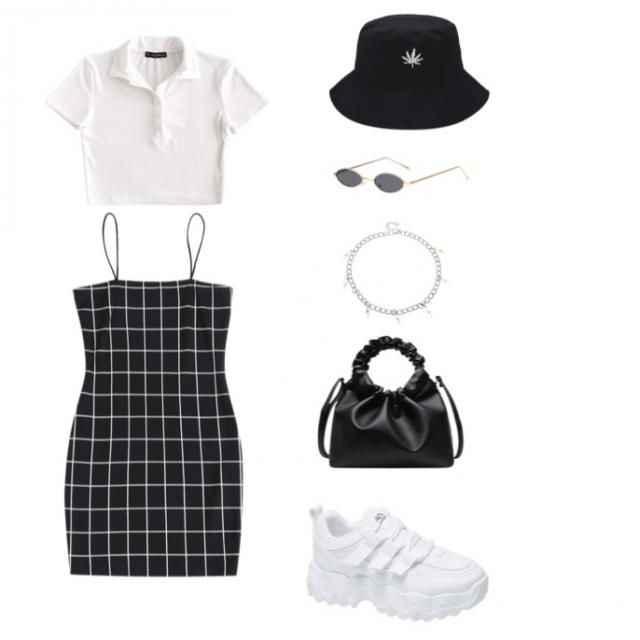 Spice it up with black and white - festival feel with this piece or a stroll along the sea front, where ever you…
