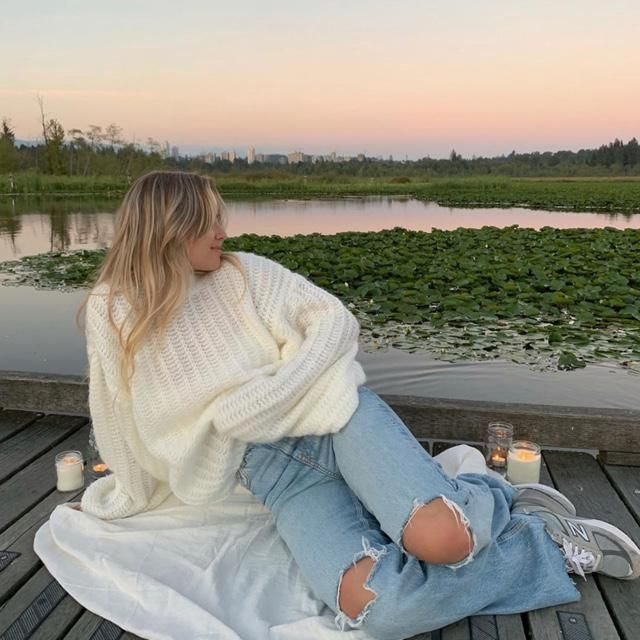 Light up candles, wear a thick and cozy sweater and have fun by the lake