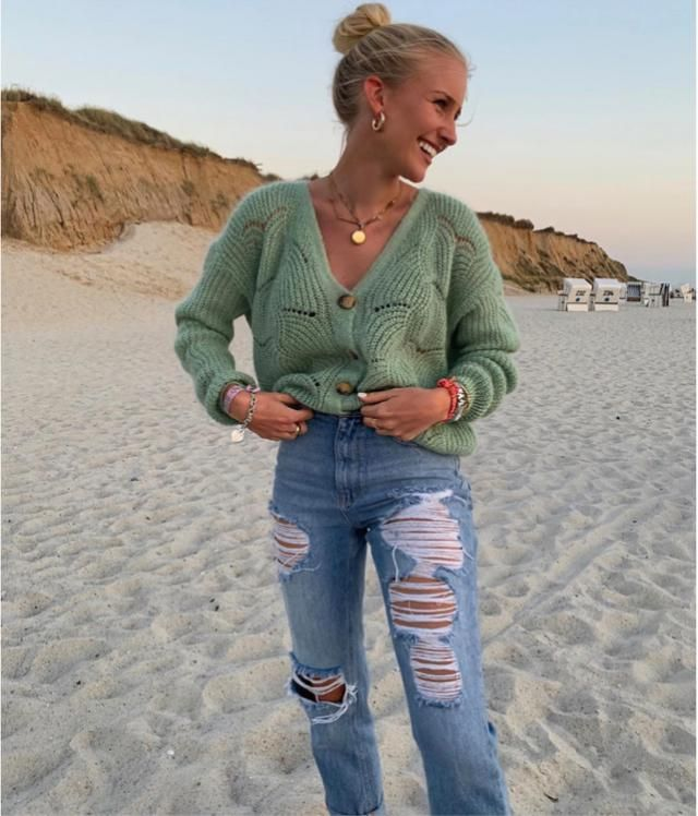 Having a good time at the beach with a cute sweater