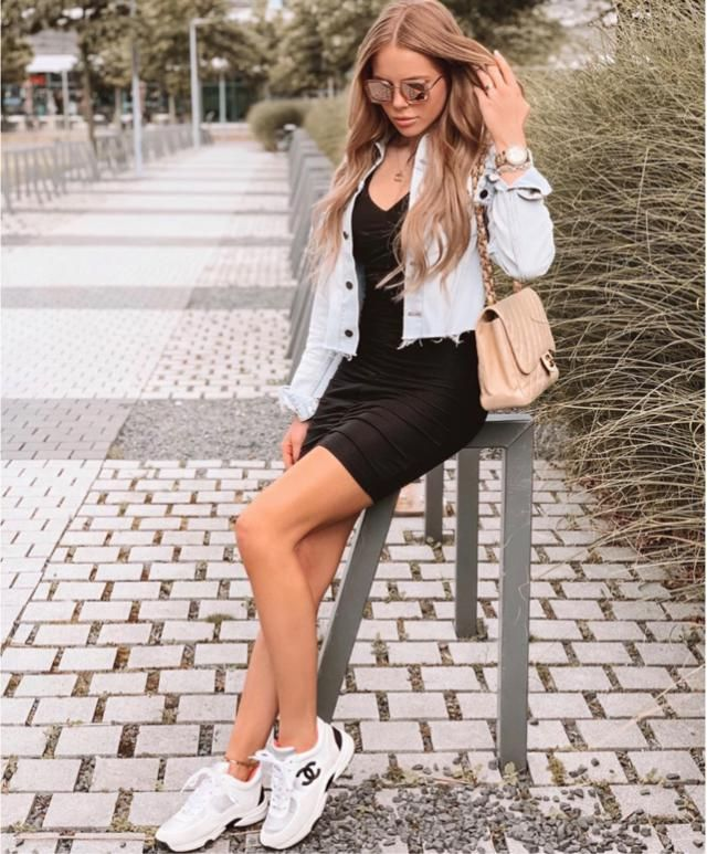 Black dress and denim jacket during the day is still glam