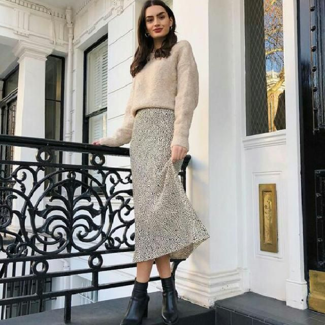 for an easy chic look try this beige cozy sweater with leopard print skirt