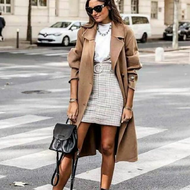 Update your casual everyday look by wearing a khaki long coat over a simple tee with plaid skirt        …
