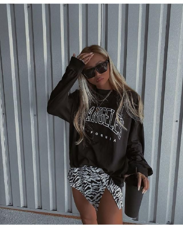 For a chic look, you can pair a boyfriend sweatshirt with skirt and heels. | | |