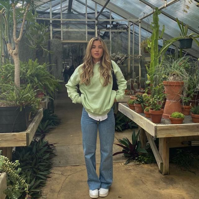 The green plants look cute with the green sweater