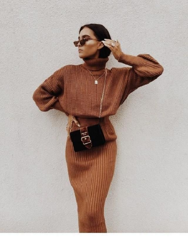 Bring a feminine charm to your two piece outfits by wearing knitted midi skirt and sweater set.                …