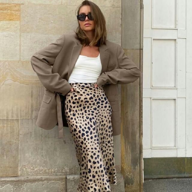 for a smart stylish look try a leopard skirt with long blazer over a simple tank top