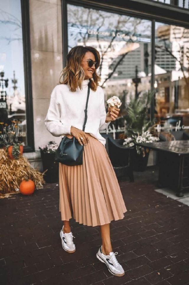 Midi skirts are so fun to dress down with a sweater and sneakers. | | |
