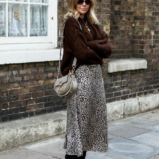 Coordinate a brown comfy sweater with leopard print skirt for another chic work outfit