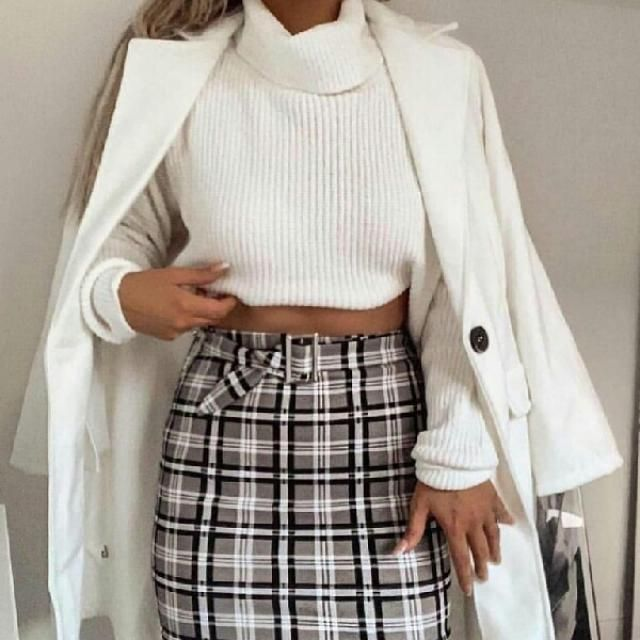 For another work outfit, coordinate a plaid short skirt and white turtleneck sweater with your white coat. Top off…