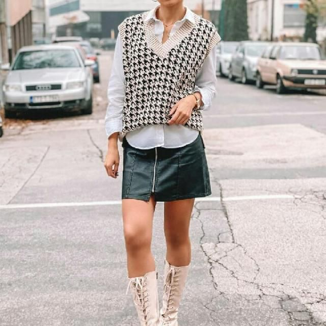 sweater vest with button up shirt and faux leather skirt