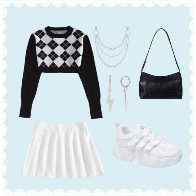 A cute cropped sweater with a small skirt. Silver jewellery and a small black bag to complete the look.
