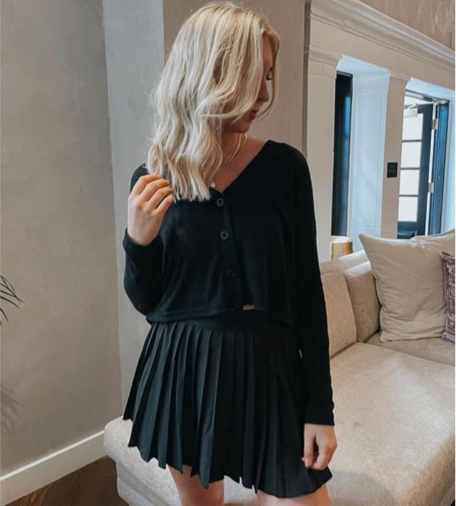 This black skirt is totally super cute even better with cardigan