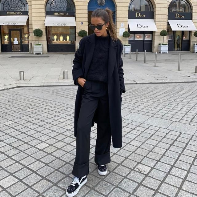 A longline coat with a nice sweater! Dont forget a simple sneaker