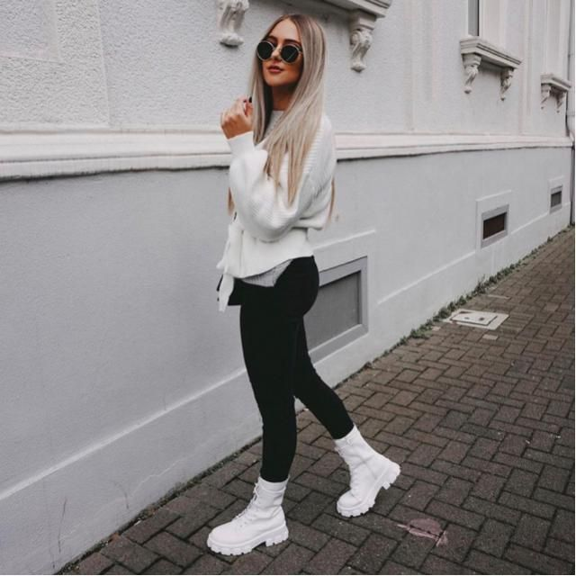 Hey there! White sweater and black leggings are gorgeous