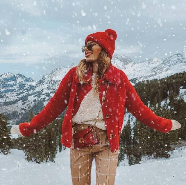 loving this red teddy coat with simple sweater and plaid pants this look gives me Christmas vibes