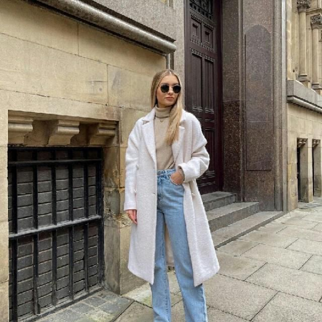 white long coat with turtleneck top and cute mom jeans