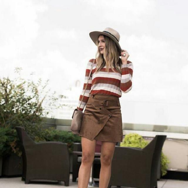 colorful sweater with brown skirt