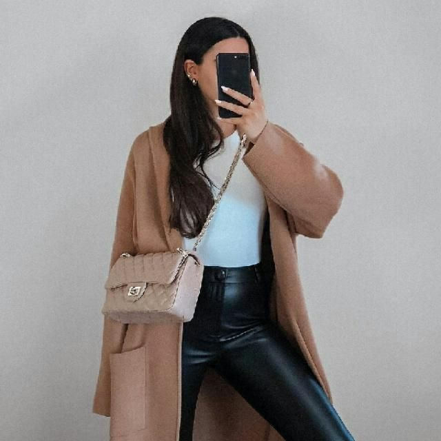 to show how effortlessly chic you are try this khaki coat with white sweater and faux leather pants