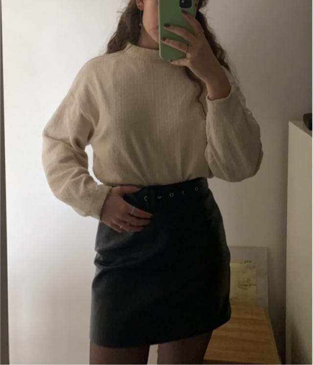 leather skirt with cream sweater.