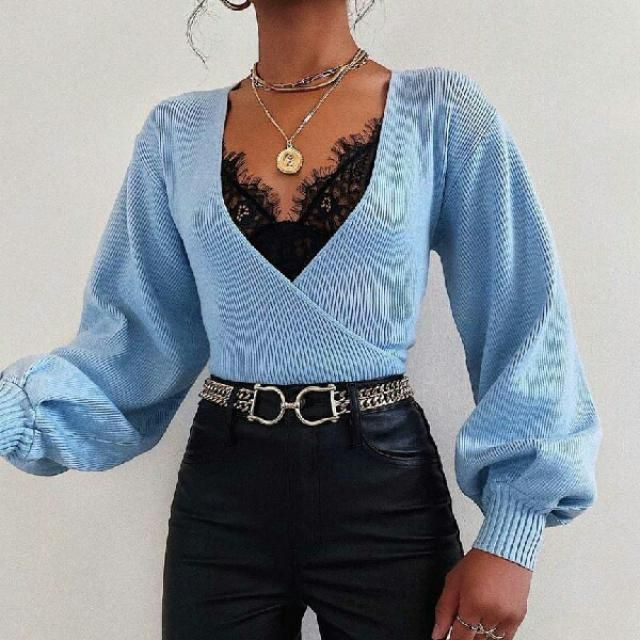 wrap pastel blue top over lace black top with leather pants