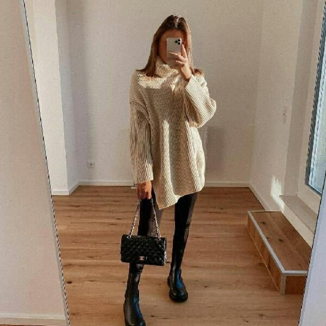 long turtleneck sweater dress with faux leather pants