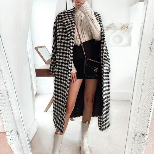 tweed long coat over beige sweater with black mini skirt