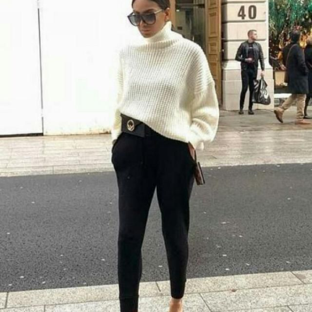chic turtleneck white sweater with black pants