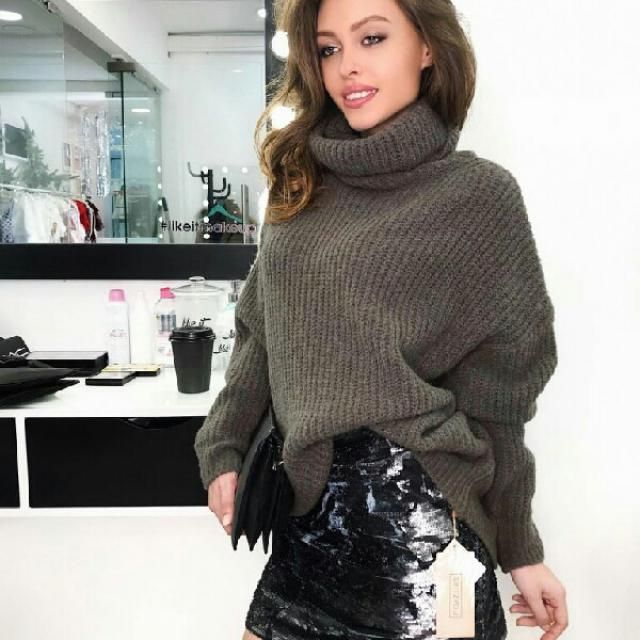 turtleneck sweater with black leather skirt