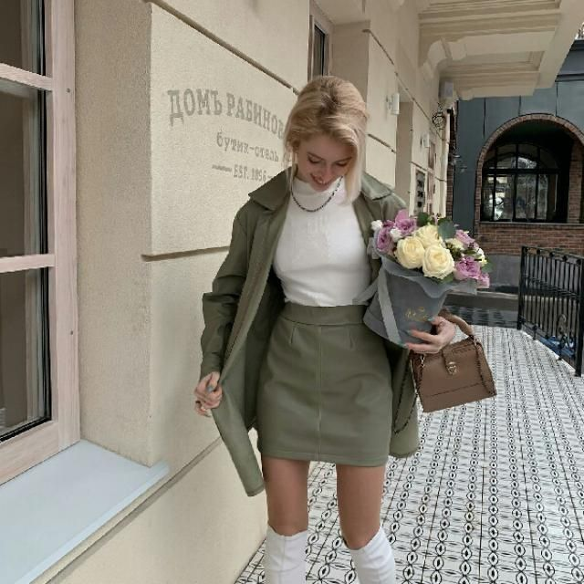 beautiful army green jacket with white turtleneck top and green skirt