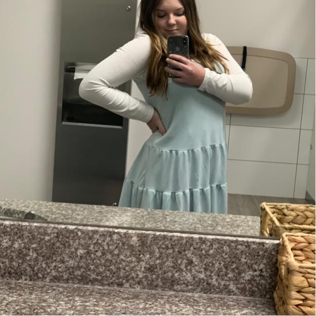 My outfit is a light blue spaghetti strap dress over a white kind sleeve shirt with half up half down pigtails