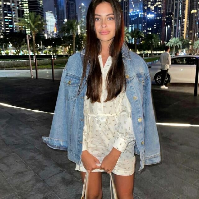 what a cute outfit, denim jacket over a lovely shirt dress