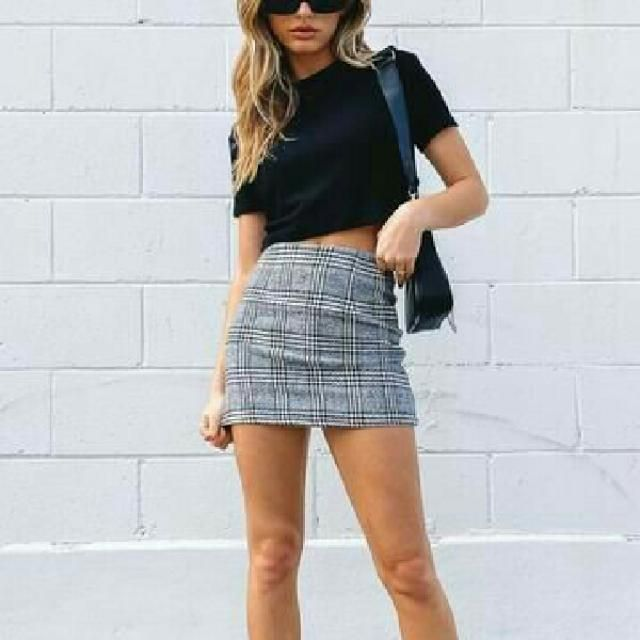 keep it simple and chix with black crop top abd plaid skirt