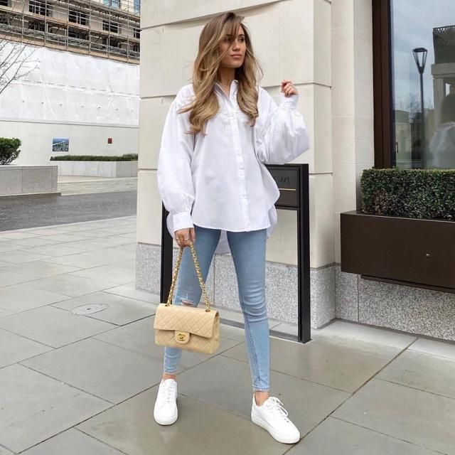 You're outfit can be just white shirts and jeans, but your bag will give your look way glamour