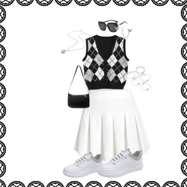 This is an outfit with a vest and a skirt. I would like to have a plain white shirt under the vest.